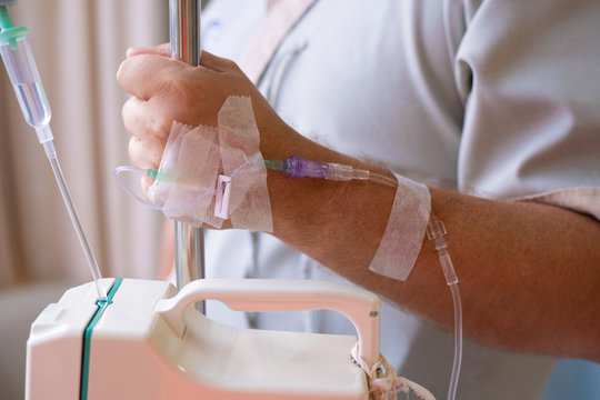 Close-up. Male hand with a dropper during chemotherapy in a hospital. Hand with a dropper. Health is a topic of health and healing