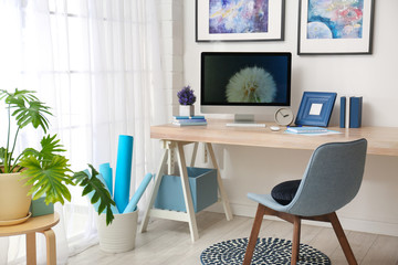 Modern workplace interior with computer on table
