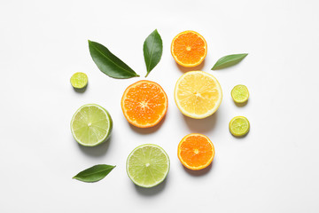 Flat lay composition with different citrus fruits on white background Fototapete