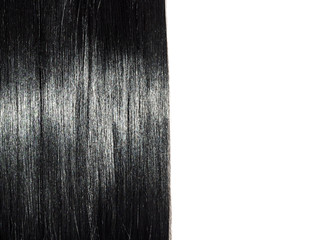 Shiny straight black hair background. Beautiful smooth brunette hair backdrop