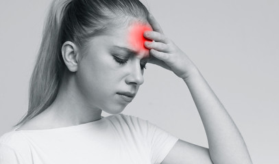 Young woman suffering from terrible strong head pain