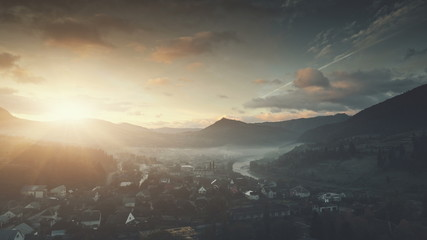 Sunrise Mountain Village Misty Weather Aerial View. Panoramic Highland Countryside Settlement Overview. Peaceful Neighborhood Building. Soft Sun Light. Tourism Concept. Drone Flight