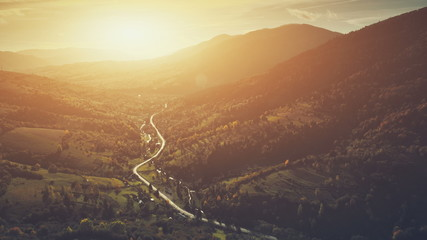 Aerial Sunset Mountain Road, Countryside Canyon Landscape. Majestic Coniferous Evergreen Forest, Wildlife Nature. Clean Ecology Eco Tourism Concept. Orange Toning Filter. Drone Flight