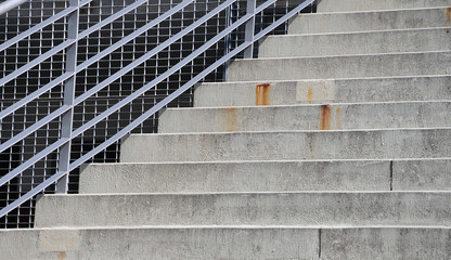 view to cement steps with a steel railing