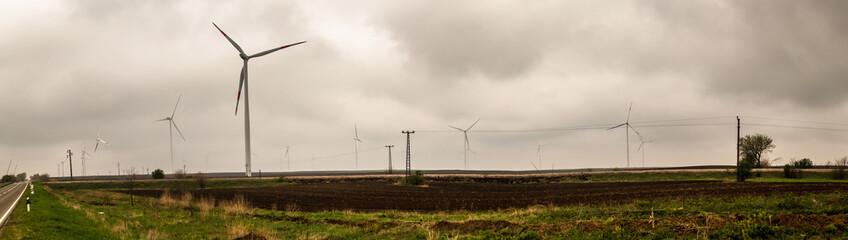 Wind generator turbine or windmill or wind farm, cloudy foggy day