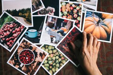 woman choosing autumn photographs