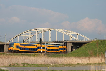 Double decker intercity train at the Moordrecht crossing heading to Den Haag in the Netherlands