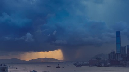 Fototapete - Victoria harbor of Hong Kong Island with sunny stormy sky, China