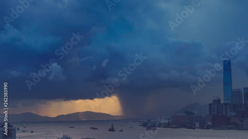 Fototapete Victoria harbor of Hong Kong Island with sunny stormy sky, China