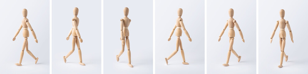 collection of wooden mannequin on white background
