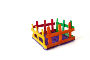 Invention of toys from colorful popsicle sticks isolated on white background.