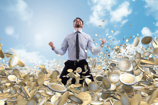 Businessman exults over a lot of money coins