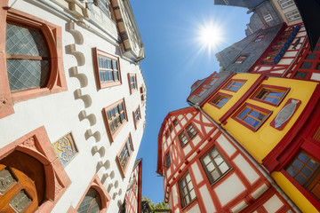 Old town Limburg an der Lahn with colorful mediaeval half timbered houses, wide angle view from down to top on a sunny day, Hesse, Germany, Europe