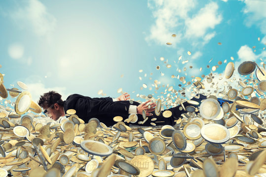 Businessman swims in a sea of money