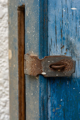 Wooden blue mailbox with a locker