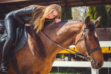 Rider elegant woman talking to her horse. Portrait of horse pure breed with woman. Equestrian horse with rider playpen for horses background  Wall mural