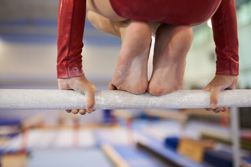 Girl gymnast prepares for acrobatics on the pole in the gym. Athletics competition.