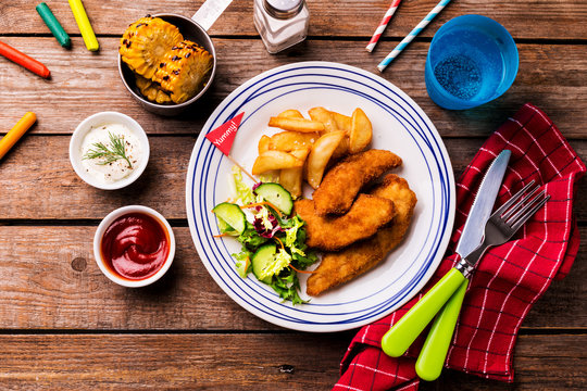 Kid's meal - chicken strips, fries, salad, corn and dips