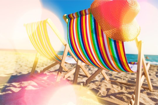 Matcheswooden chaise longue chairs on beach