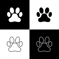 Set Paw print icons isolated on black and white background. Dog or cat paw print. Animal track. Vector Illustration