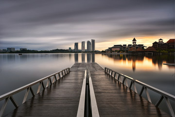 Wall Mural - Jetty bridge with background of buildings in putrajaya, malaysia