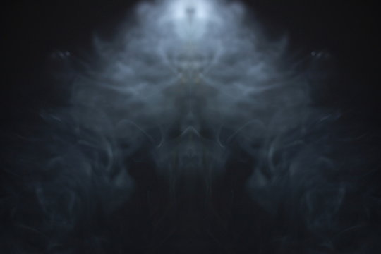 horror smoke texture background in black room . projector light beam in the air . ghost screening concept .
