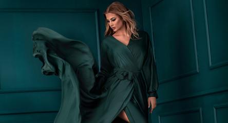 Fashion lady in green maxi dress. Wall mural