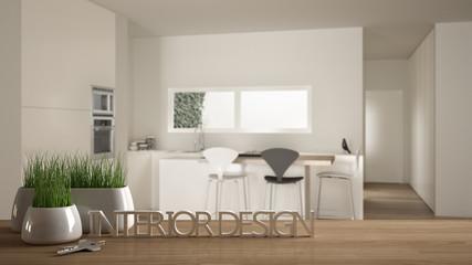 Deurstickers Boho Stijl Wooden table, desk or shelf with potted grass plant, house keys and 3D letters making the words interior design, over blurred modern kitchen, project concept copy space background