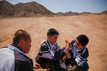 Students build a toy rocket at the C-Space Project Mars simulation base in the Gobi Desert outside Jinchang