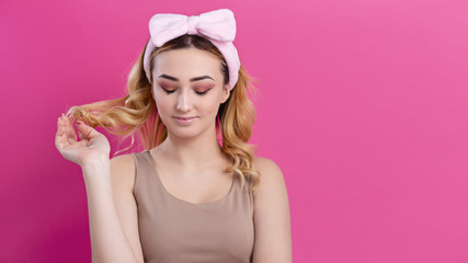 Wall Mural - portrait of a beautiful girl woman in a headband for make up on a studio background, concept of beauty, advertising cosmetics, body care