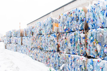 Plastic bales of rubbish at the waste treatment processing plant. Recycling separatee and storage of garbage for further disposal, trash sorting. Business for sorting and processing of waste. Wall mural