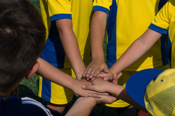 children's men's soccer team get ready for the game and is charged with fighting spirit during a general handshake on the field