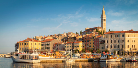 Colorful morning in Rovinj, Istria with boats in the port, Croatia