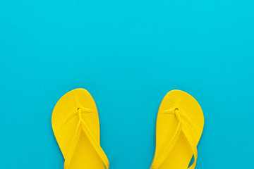 ada179799 yellow beach flip-flops on the blue background