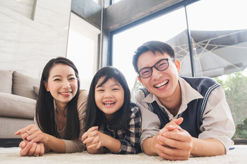 Portrait happy asian family at living room