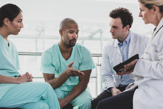 African American medical professional discussing patient treatment in a hospital