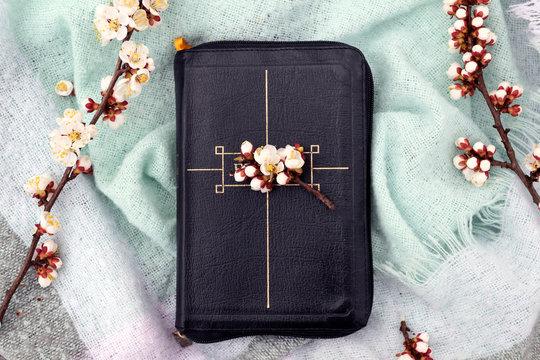 Brest, Belarus - April 17, 2019: Book Bible, floral background. Christianity Religion Faith concept.