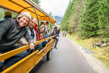 Fototapeta Family enjoying nature from horse drawn carriage, Tatra Mountains National Park, Poland obraz