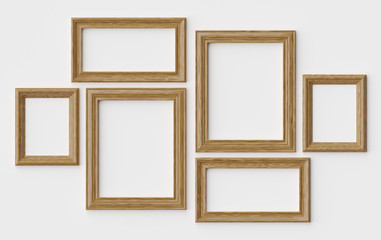 Wooden picture or photo frames on white wall with shadows