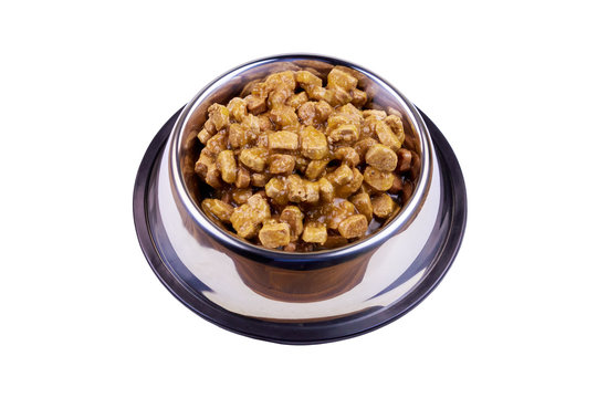 Canned food for cats or dogs in metal bowl isolated on white background