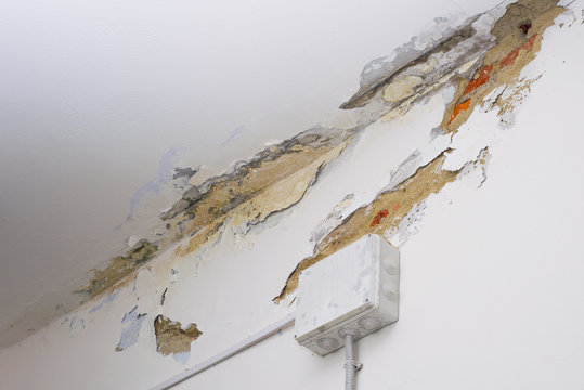 Damage ceiling from water pipelines leakage. Housing problem concept