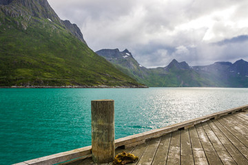 Tuinposter Bergen clouds over the fjord on Senja island in Norway
