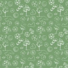 Seamless pattern with 2d trees and trees in plan view. Hand drawn sketch. White symbols on green background.