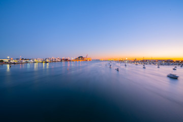 Lights of Port of Tauranga and harbor at dawn