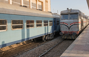 Railway locomotive and carriages at a station platform