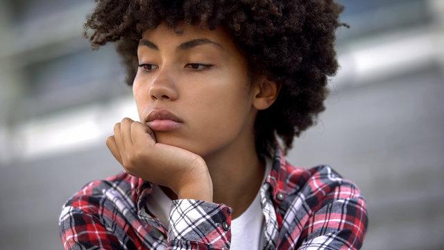 Upset afro-american woman portrait, racial discrimination problem, bullying