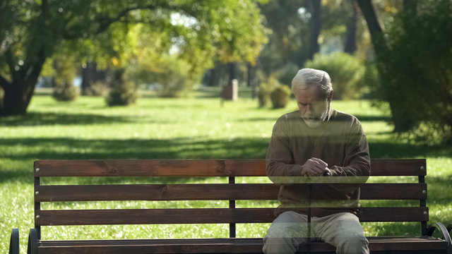 Lonely old man disappearing from bench, concept of death, transience of life