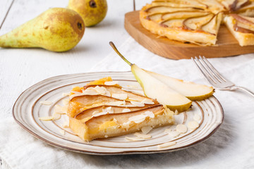 Puff pastry pies with cheese and pear in a plate
