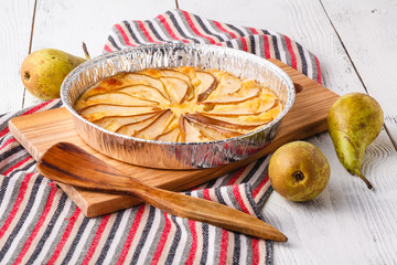 Pears and cheese pie (quiche), bowl of cream