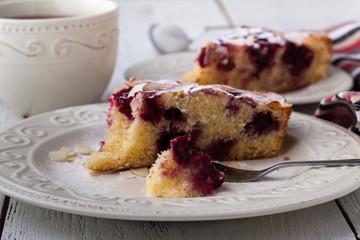 Breakfast concept, Homemade slice of shortbread dough raspberry pie with almond petals